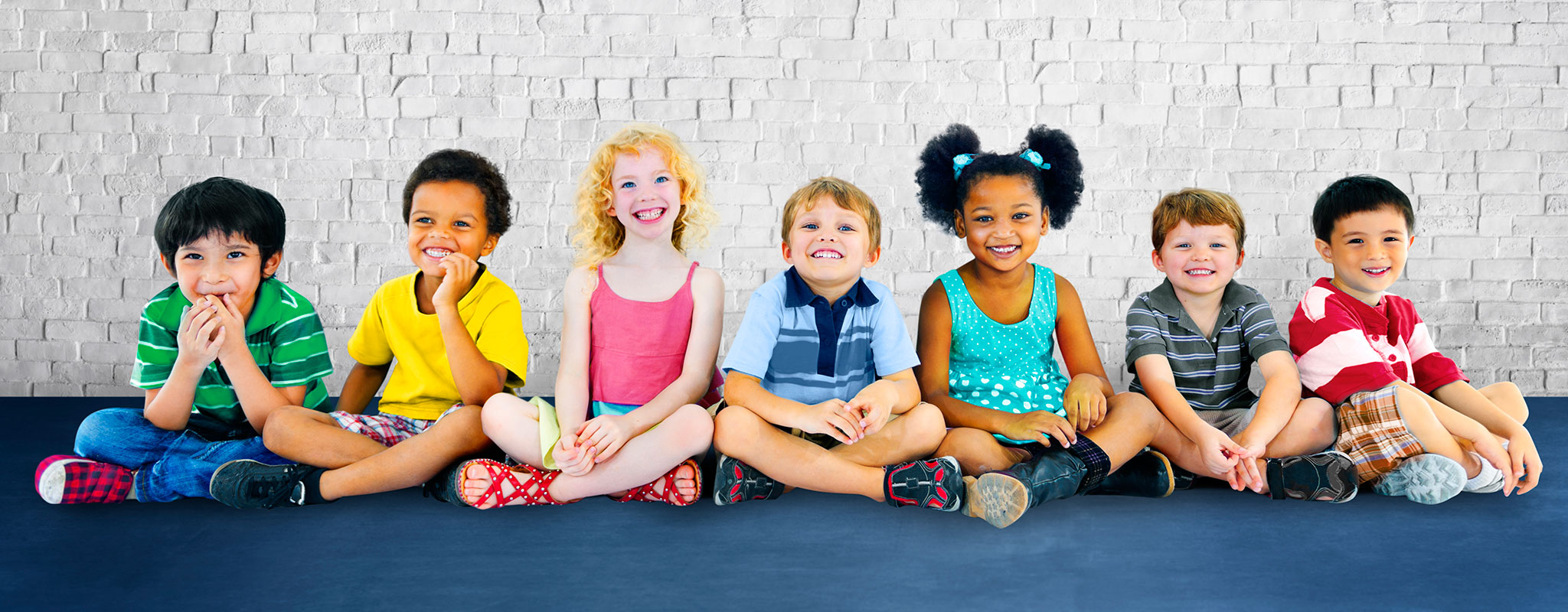 Group of kids sitting on floor Banner image for Gwinnett Pediatrics and Adolescent Medicine, Gwinnett Pediatricians